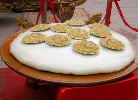 weighs: This giant rice cake weighs 110kg, 100kg made of glutinous rice and 10kg of green beans at Cao temple festival on March, 4, 2013 in Hai Duong, Vietnam Editorial