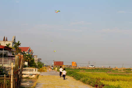 HAI DUONG, VIETNAM, September, 9: the rural boy, about 10 years old, playing Kite on September, 9, 2013 in Hai Duong, Vietnam