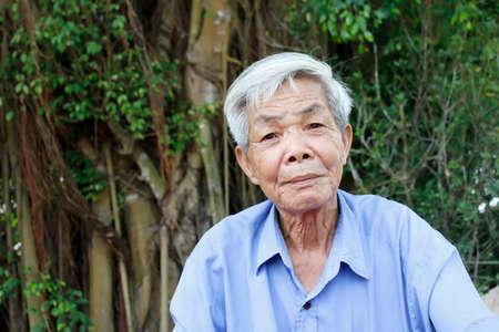 asian old man: HAI DUONG, VIETNAM, September, 8: Asian old man says and smiles on September, 8, 2013 in Hai Duong, Vietnam