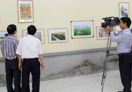 HAI DUONG, VIETNAM, September, 13: reporter films in painting exhibition on September, 13, 2012 in Hai Duong, Vietnam