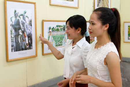 HAI DUONG, VIETNAM, September, 13: Girls watch picture exhibition on September, 13, 2012 in Hai Duong, Vietnam