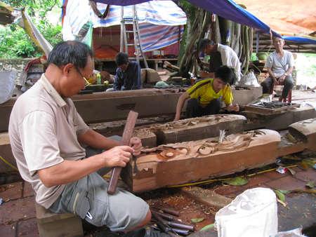 adult vietnam: HAI DUONG, VIETNAM, September, 5: carpenter building a temple in rural Vietnam on 5, 2013 in Hai Duong, Vietnam Editorial