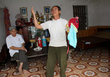 HAI DUONG, VIETNAM, September, 21: Vietnamese Folk artists perform Tuong in home on September, 21, 2013 in Hai Duong, Vietnam. Tuong is unique theater art in Vietnam