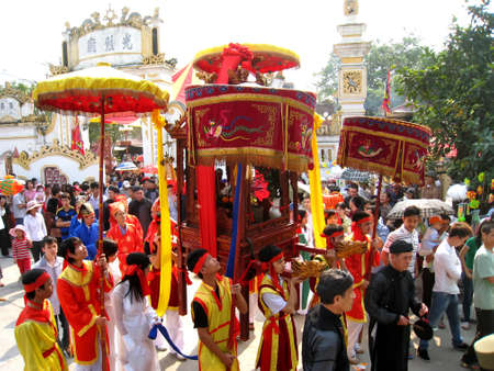 palanquin: HAI DUONG, VIETNAM, April 12: Group of people in traditional costume palanquin procession holy at Suot temple festival on April, 12, 2013 in Hai Duong, Vietnam. palanquin procession of holy is the sacred ceremonie of festival