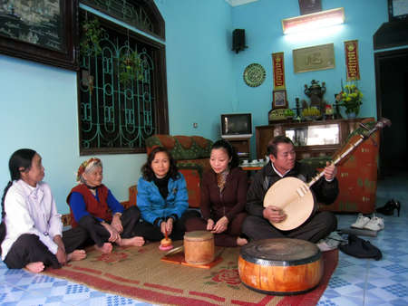DUONG, VIETNAM, September, 26: farmers sing folk songs at home on September, 26, 2013 in Hai Duong, Vietnam