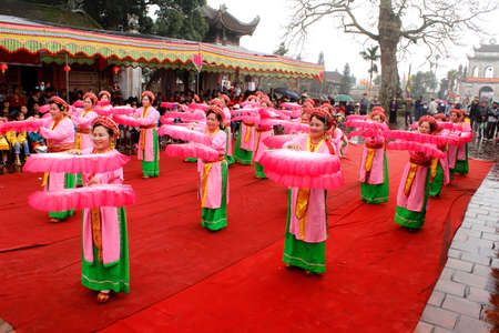 HAI DUONG, VIETNAM, March 29: people in traditional costumes arrange letters in new year for luck at Mao Dien temple on March, 29, 2014 in Hai Duong, Vietnam. This is the beauty to honor the learning.