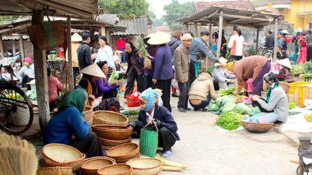HAI DUONG, VIETNAM, APRIL, 10: Asian woman selling bamboo basket at market on April, 10  in Hai Duong, Vietnam.