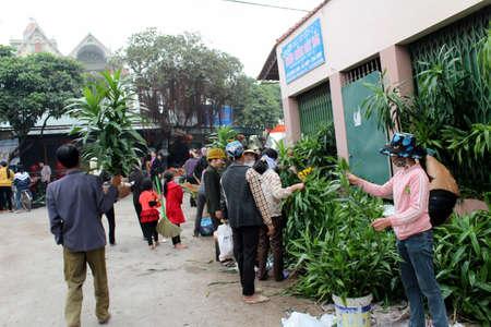 HAI DUONG, VIETNAM, APRIL, 10: Asian woman selling flowers in the market on April, 10  in Hai Duong, Vietnam.