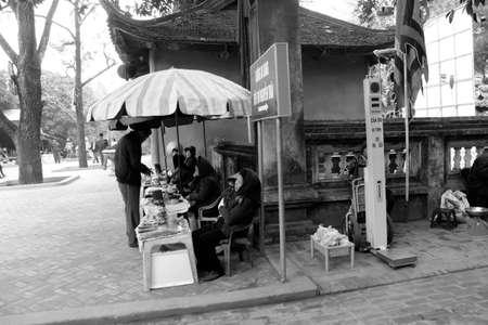 HAI DUONG, VIETNAM, APRIL, 10: Asian woman selling incense in the market on April, 10  in Hai Duong, Vietnam.