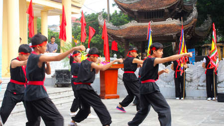 viet vo dao: HAI DUONG, VIETNAM, JULY, 23: The martial arts practitioners performance traditional martial arts on july, 23, 2013 in Hai Duong, Vietnam. Name of the martial art is Nhat Nam