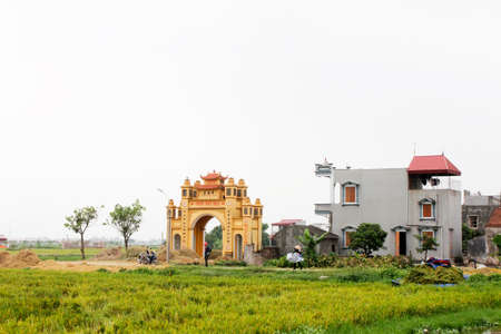 HAI DUONG, VIETNAM, JULY 30: Gate in vietnamese rural village on july, 30, 2014 in Hai Duong, Vietnam. This is special characteristics of rural Vietnam Editorial