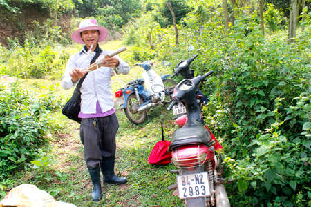 HAI DUONG, VIETNAM, May, 20: young man go trapping birds in the forest on May, 20, 2014 in Hai Duong, Vietnam.