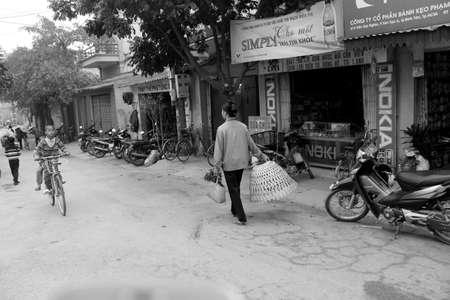 HAI DUONG, VIETNAM, February, 14: Asian peole in rural market on February, 14, 2014 in Hai Duong, Vietnam.