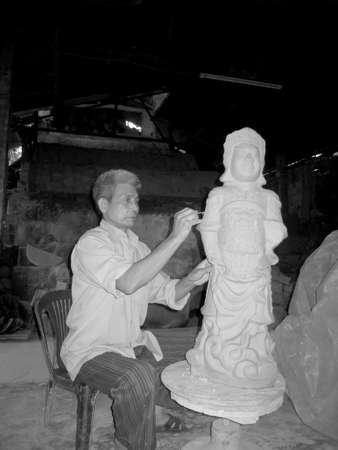 clay modeling: HAI DUONG, VIETNAM, July, 18: man of Cay pottery village  clay modeling on July, 18,2013 in Hai Duong, Vietnam. Here is the famous pottery village.