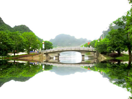 tam: NINH BINH, VIETNAM, JULY, 20: Unidentified tourists in Trang An  on JULY, 20, 2013. Trang An is the scenic area, ranked special of Vietnam.