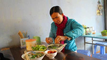 HAI DUONG, VIETNAM, January,30: woman eat fish noodle on January, 30, 2014 in Hai Duong, Vietnam