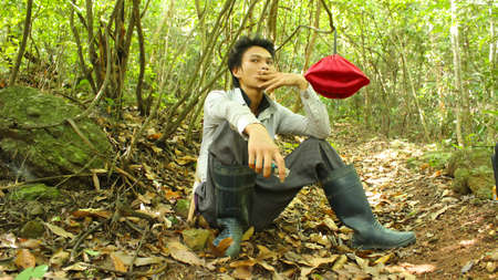 adult vietnam: HAI DUONG, VIETNAM, AUGUST, 20: Asian young adult smoking on August, 20, 2014 in Hai Duong, Vietnam. Editorial