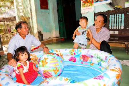 HAI DUONG, VIETNAM, AUGUST, 20: Grandparents Playing With Grandchildren on August, 20, 2014 in Hai Duong, Vietnam.