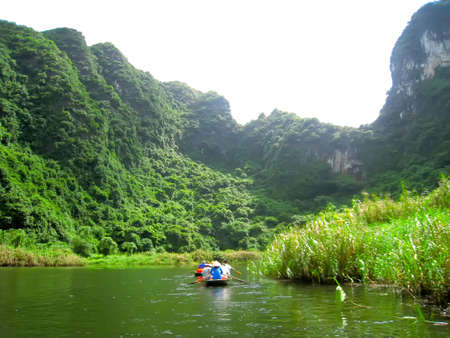 ranked: NINH BINH, VIETNAM, JULY, 20: Unidentified tourists in Trang An  on JULY, 20, 2013. Trang An is the scenic area, ranked special of Vietnam Editorial