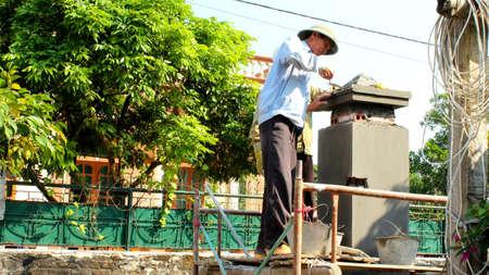 HAI DUONG, VIETNAM, May, 20: Construction workers construction workers plasterings house on May, 20, 2014 in Hai Duong, Vietnam