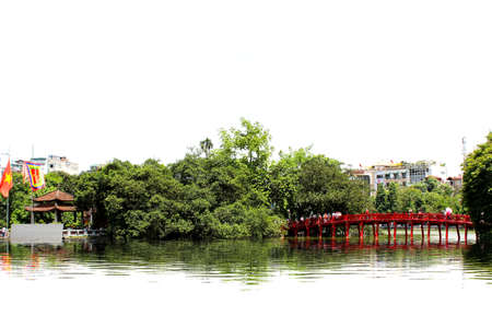 Red bridge from shore to lake