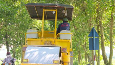 steamroller: HAI DUONG, VIETNAM, JULY, 30: worker control steamroller working in road on july, 30, 2014 in Hai Duong, Vietnam.