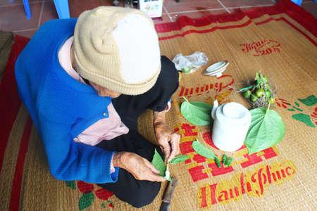 areca: Haiduong, Vietnam, December, 27, 2014: Woman making betel with betel and areca.  Customs of betel chewing is longstanding in Vietnam
