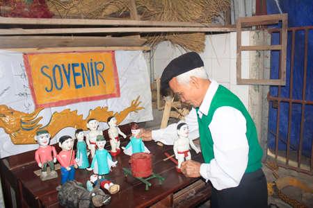 HAI DUONG, VIETNAM, JANUARY, 2: artisans make water puppetry in Vietnam on January, 2, 2015 in Hai Duong, Vietnam Editorial