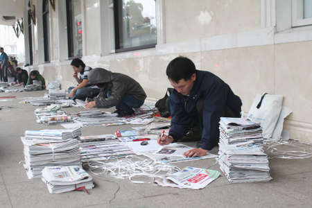 roadside stand: Hanoi, Vietnam, March, 27: people selling newspapers on the street on March, 27, 2015 in Hanoi, Vietnam