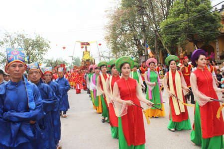 traditional festivals: Haiduong, Vietnam, March, 31, 2015: group of people attending traditional festivals