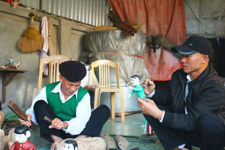 HAI DUONG, VIETNAM, DECEMBER, 31: artisans make water puppetry in Vietnam on december, 31, 2014 in Hai Duong, Vietnam