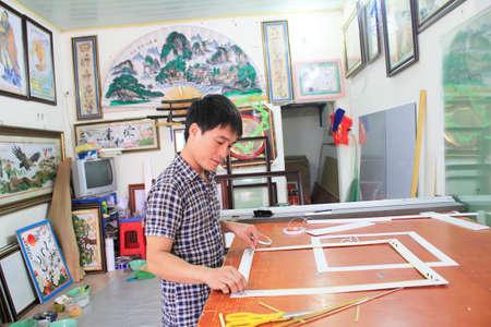 Haiduong, Vietnam, February, 17: Craftsman working on frame in frame shop on February, 17, 2015 in Hai Duong, Vietnam