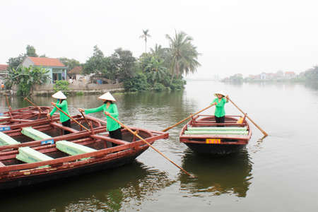 Haiphong, Vietnam, May, 1: people boating in the river on May, 1, 2014 in haiphong, Vietnam