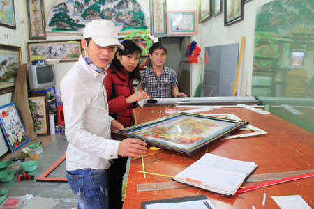 framer: Haiduong Vietnam February 17: Craftsman working on frame in frame shop on February 17 2015 in Hai Duong Vietnam