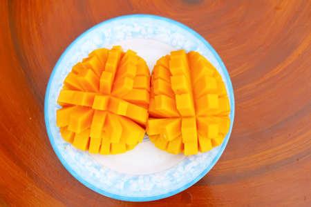 Mango slice cut to cubes close-up