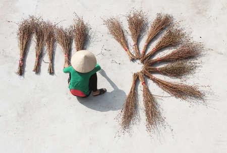 Girl drying brooms Stok Fotoğraf