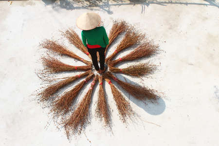 Girl drying brooms Stockfoto