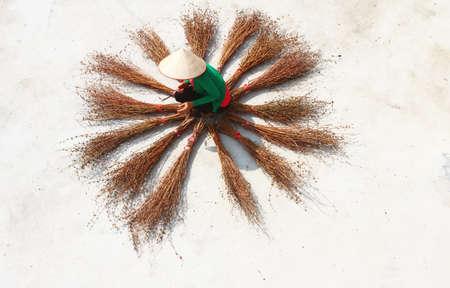 Girl drying brooms Foto de archivo