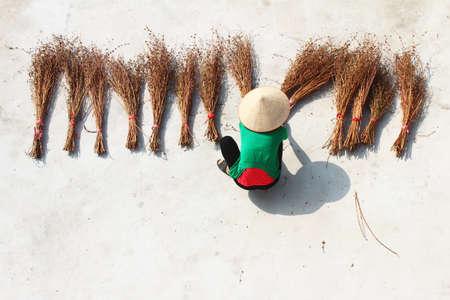 brooms: Girl drying brooms Stock Photo