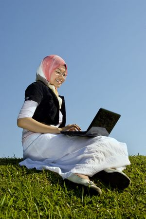 Asian women with laptop outdoor  Stock Photo