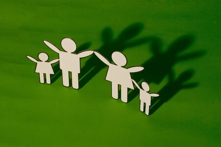 Paper cutout of a family happy together with shadow