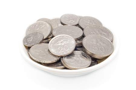 Malaysia coins ten, twenty and fithty cents in plate with isolated white background photo