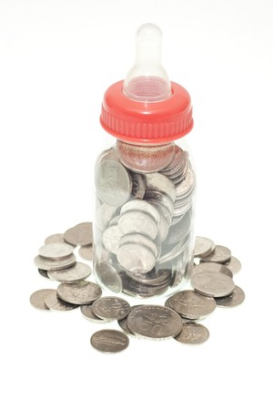 Malaysia Coins in Baby Bottle Conceptual Image to Represent the Cost of Raising Children.
