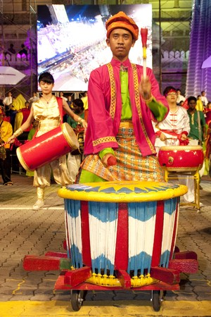 KUALA LUMPUR, MALAYSIA - MEI 21 : Participant wearing malay traditional costume playing the rebana ubi during the rehearsal of Colours of Malaysia Festival Mei 21, 2010 in Kuala Lumpur Malaysia. Editorial