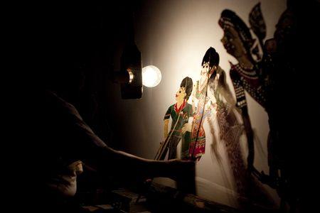 puppet show: A Tok Dalang Preforming the Tradtional Malaysian Shadow Puppet Show (Wayang Kulit)