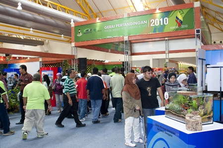 KUALA LUMPUR - NOVEMBER 30 : Visitors to Malaysian Agriculture, Horticulture and Agrotourism Show (MAHA) admiring miniature landscape on display November 30, 2010 in Kuala Lumpur, Malaysia.