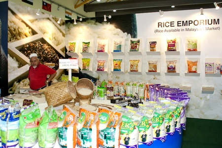 KUALA LUMPUR - NOVEMBER 30 : A unidentified visitor at Rice Emporium exhibit during Malaysian Agriculture, Horticulture and Agrotourism Show November 30, 2010 in Kuala Lumpur, Malaysia.