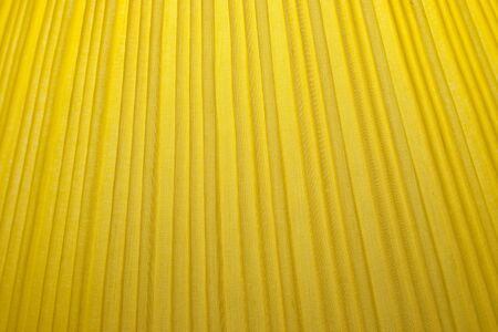 Close up Structure of Yellow Fabric Texture use a Background photo
