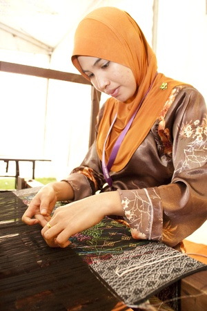 KUALA LUMPUR, MALAYSIA - MARCH 4: Fatehah Ibrahim, a traditional Songket weaver does a demonstration at the Malaysia National Craft Day 2011 on March 4, 2011 in Kuala Lumpur, Malaysia