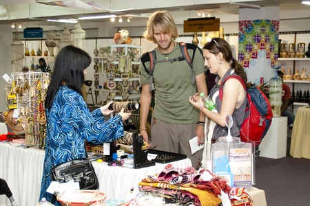 KUALA LUMPUR, MALAYSIA - MARCH 4: A tourist couples is seen making a selection of handmade craf  at the Malaysia National Craft Day 2011 on March 4, 2011 in Kuala Lumpur, Malaysia.